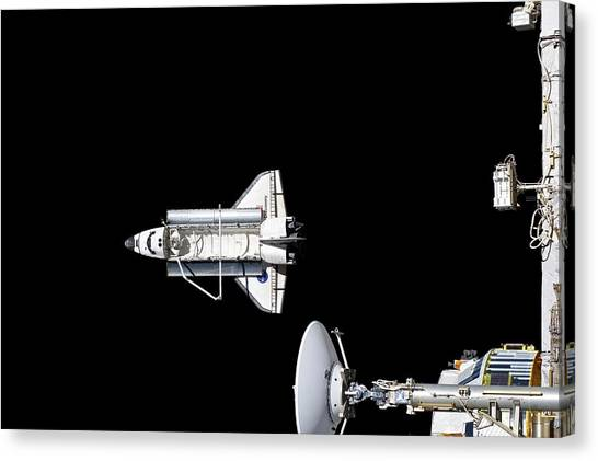 Discovery Departing The Iss Canvas Print by Nasa/science Photo Library