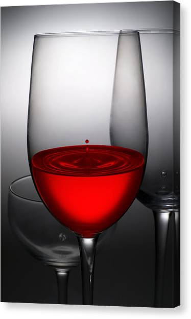 Pour Canvas Print - Drops Of Wine In Wine Glasses by Setsiri Silapasuwanchai