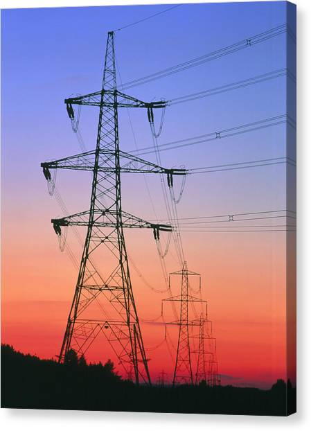Electricity Pylons & Transmission Lines At Sunset by Martin Bond/science  Photo Library