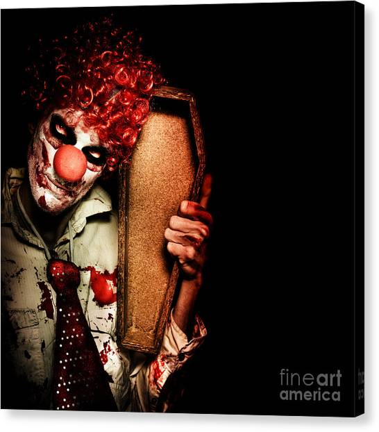 Health Care Canvas Print - Evil Horrible Clown Holding Coffin In Darkness by Jorgo Photography - Wall Art Gallery