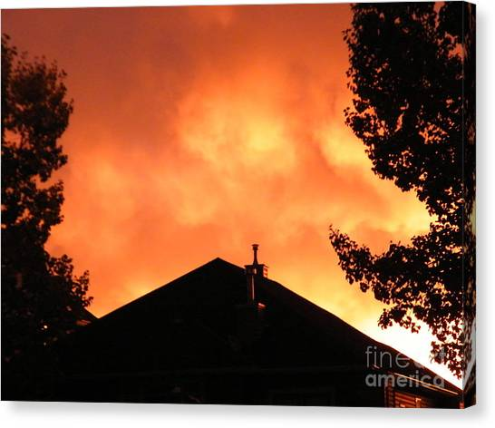Canvas Print featuring the photograph Fire In The Sky by Ann E Robson