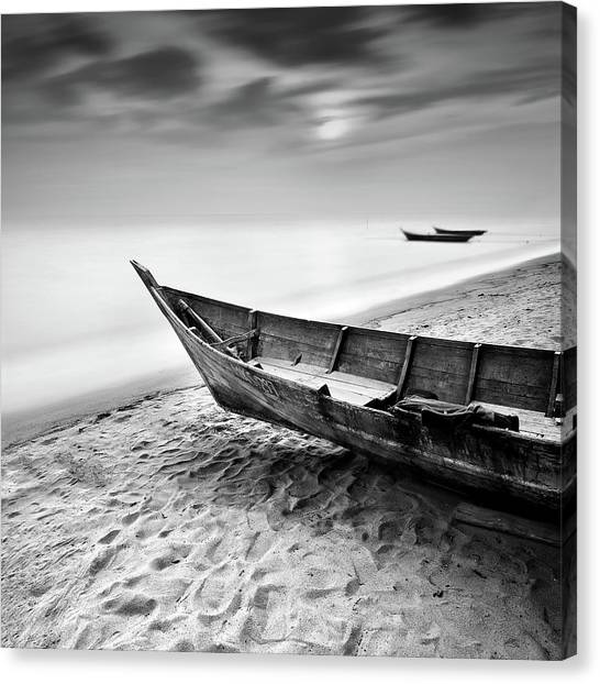 Fisherman Boat At Beach In Black And Canvas Print by Photography By Azrudin