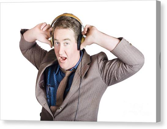 Headphones Canvas Print - Funny Businessman Wearing Earphones On White by Jorgo Photography - Wall Art Gallery