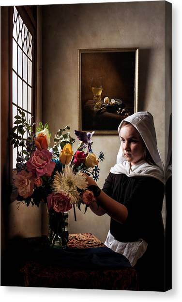 Girl Arranging A Flower Bouquet In A Glass Vase Canvas Print