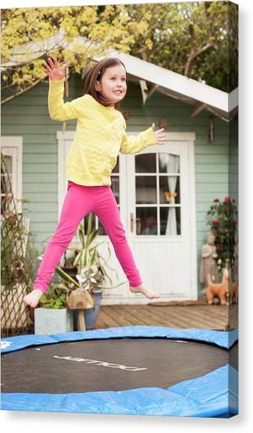 Trampoline Canvas Print - Girl Bouncing On A Trampoline by Ian Hooton