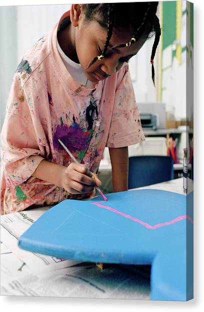Classroom Canvas Print - Girl Painting At School by Martin Riedl/science Photo Library