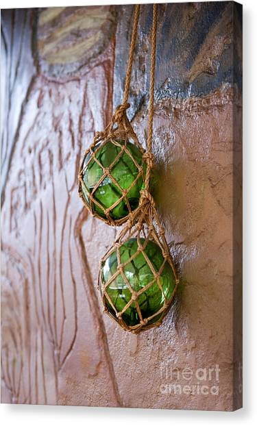 Binders Canvas Print - Green Glass Balls Hanging On The Wall  by Arletta Cwalina