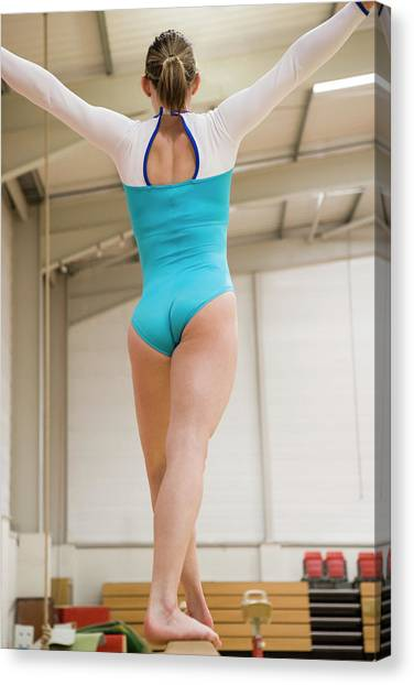 Balance Beam Canvas Print - Gymnast On A Balance Beam by Gustoimages/science Photo Library