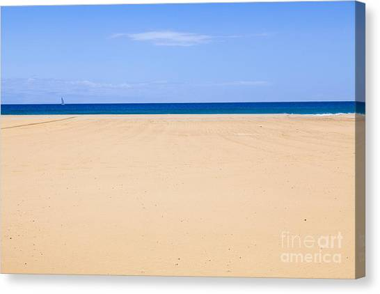 Horizontal Lines Of Sandy Beach Blue Sea And Sky Canvas Print