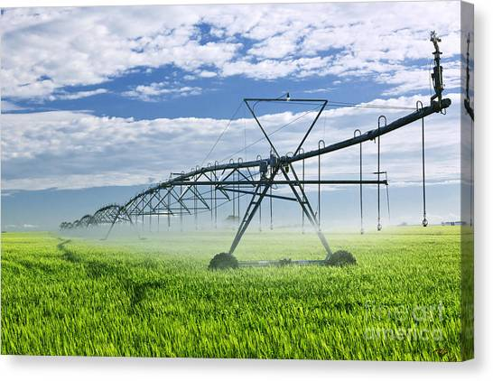 Saskatchewan Canvas Print - Irrigation Equipment On Farm Field by Elena Elisseeva