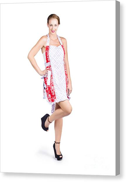 Economics Canvas Print - Isolated Woman In Kitchen Apron by Jorgo Photography - Wall Art Gallery