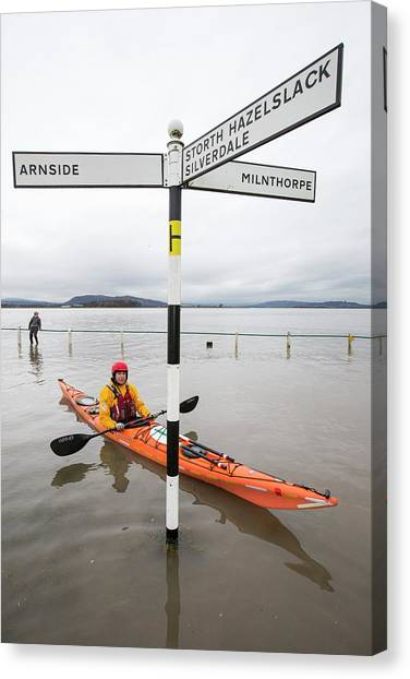 Kayaks Canvas Print - Kayakers In The Flood Waters by Ashley Cooper