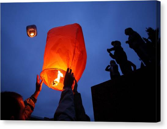 Launching Wish Lanterns Canvas Print by Science Photo Library