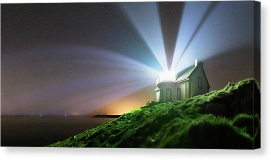 Night Caps Canvas Print - Lighthouse Beams At Night by Laurent Laveder
