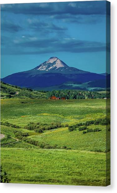 Log Cabin Canvas Print - Log Cabin With Mountains And Green by Panoramic Images