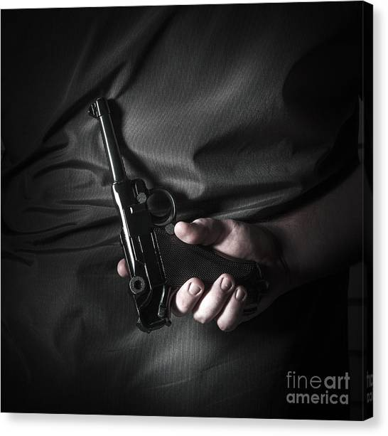 Gun Control Canvas Print - Male Hand Hiding Vintage Luger Pistol Behind Back by Jorgo Photography - Wall Art Gallery