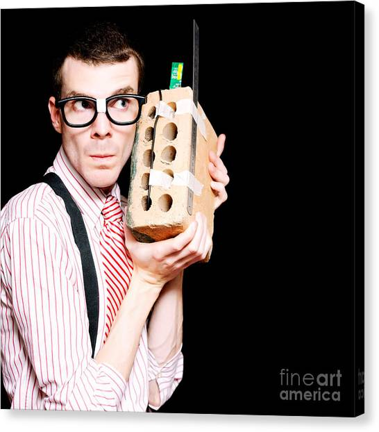 Braces Canvas Print - Male Nerd Inventor Holding Brick Mobile Telephone by Jorgo Photography - Wall Art Gallery