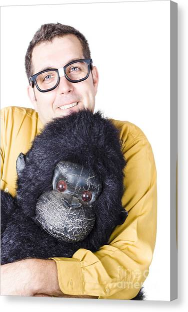 Gorillas Canvas Print - Man Holding Gorilla Costume by Jorgo Photography - Wall Art Gallery