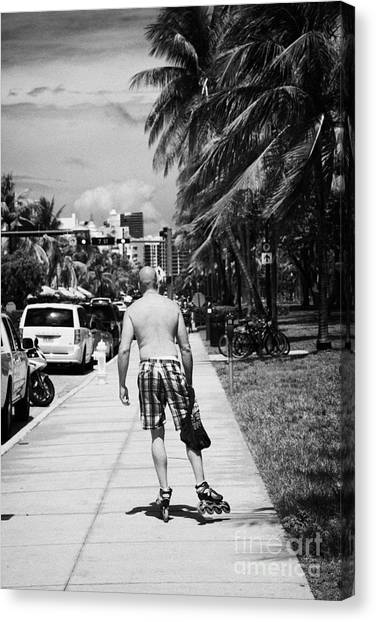 Rollerblading Canvas Print - Man Rollerblading Along Ocean Drive Early Morning Art Deco District Miami South Beach Florida Usa by Joe Fox