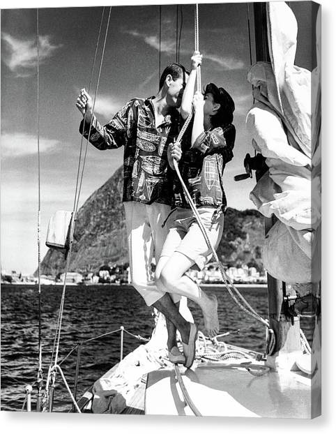 Models Wearing A Bennett Shirts On A Sailboat Canvas Print by Richard Waite
