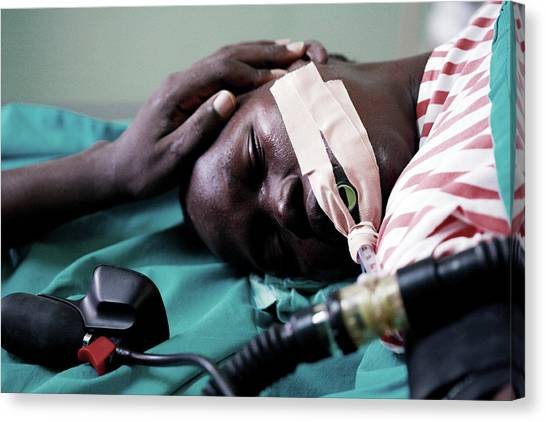 Monitoring A Patient's Heart Rate Canvas Print by Mauro Fermariello/science Photo Library