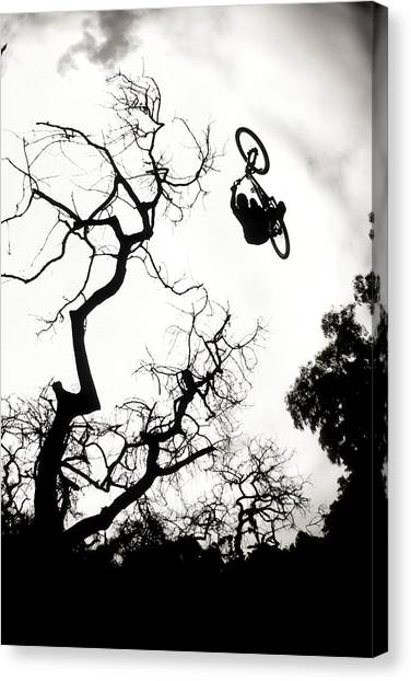 Freeriding Canvas Print - Mountain Biker Catching Air As He Makes by Scott Markewitz