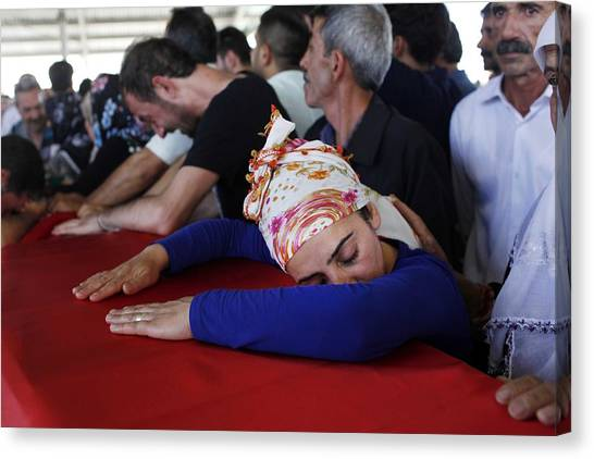 Mourners Attend The Funerals Of Those Killed In The Turkish Bomb Blast Canvas Print by Gokhan Sahin