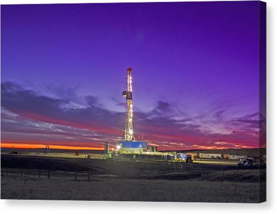 Oil Fracturing Drilling Rig At Dusk Canvas Print by Rich LaSalle