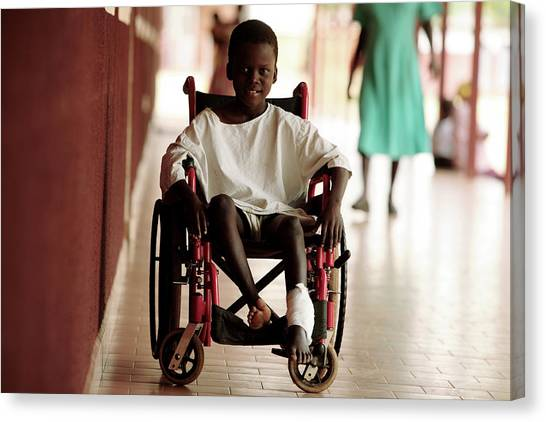 Patient In A Wheelchair Canvas Print by Mauro Fermariello/science Photo Library