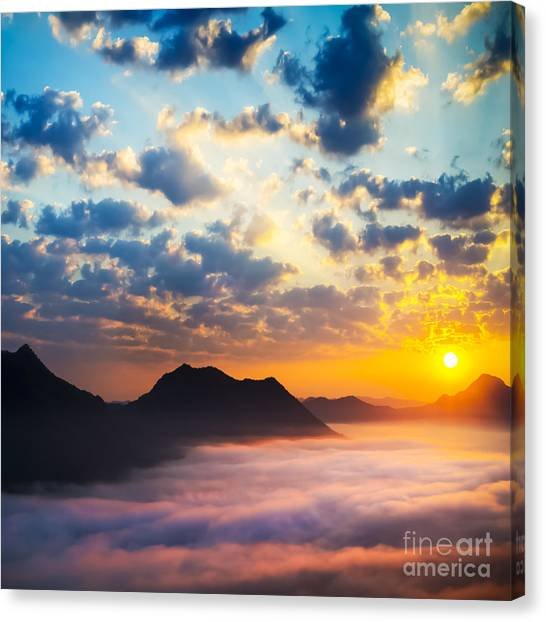 Sun Canvas Print - Sea Of Clouds On Sunrise With Ray Lighting by Setsiri Silapasuwanchai