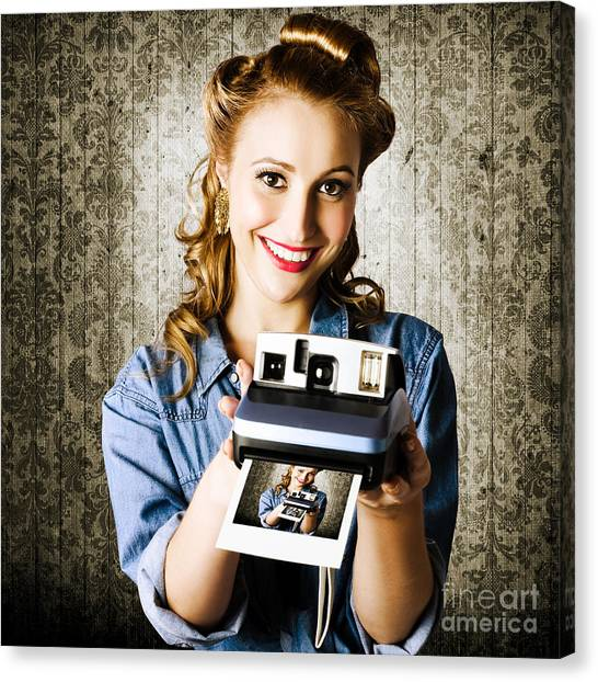 Vintage Polaroid Canvas Print - Smiling Young Vintage Girl Taking Polaroid Photo by Jorgo Photography - Wall Art Gallery