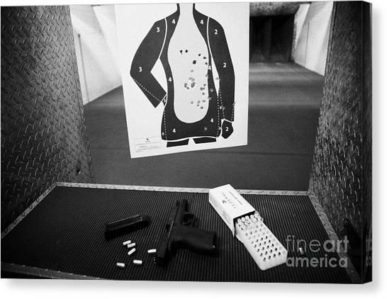 Smith And Wesson 9mm Handgun With Ammunition At A Gun Range Canvas Print by Joe Fox