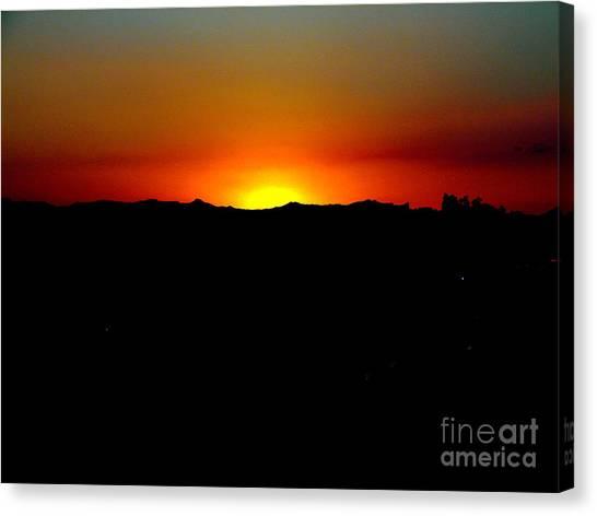 Sunset Over Arizona Canvas Print by John Potts