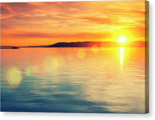 Sunset Over Water Canvas Print by Focusstock