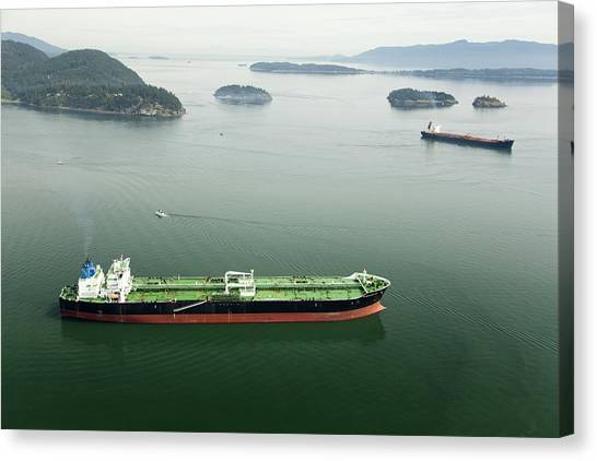 Tanker Ships At Anchor Offshore Of The Canvas Print by Andrew Buchanan/SLP