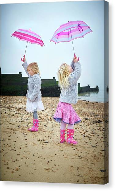 Two Girls On Beach Holding Umbrellas Canvas Print by Ruth Jenkinson