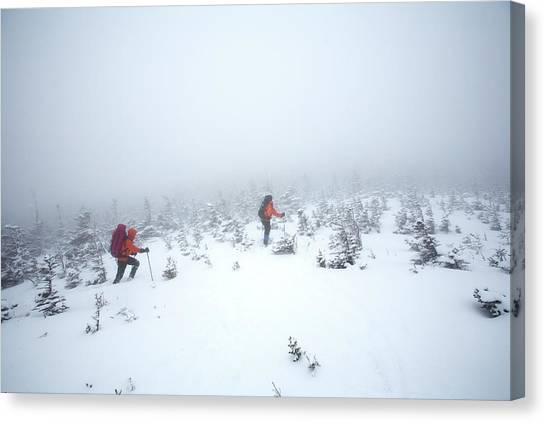 Ice Climbing Canvas Print - Two Men Hiking In The Snow On Mt by Jose Azel