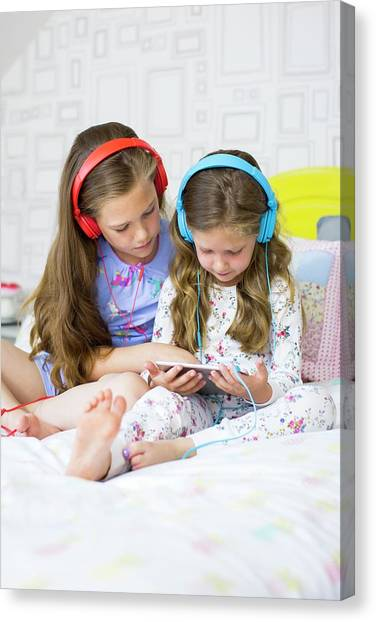 Big Sister Canvas Print - Two Sisters In Bedroom by Science Photo Library