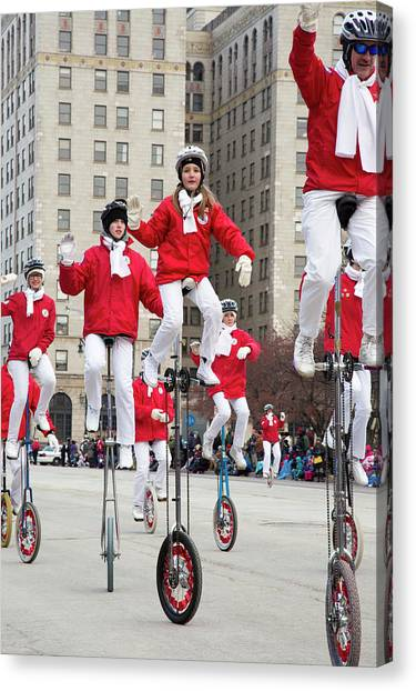Acrobatic Canvas Print - Unicyclists At A Parade by Jim West