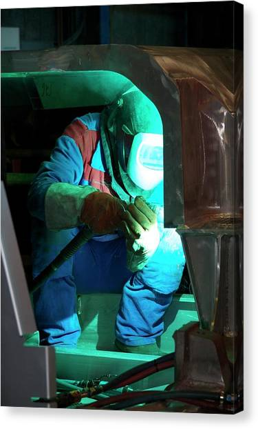 Protective Clothing Canvas Print - Welding In Train Construction by Andrew Wheeler