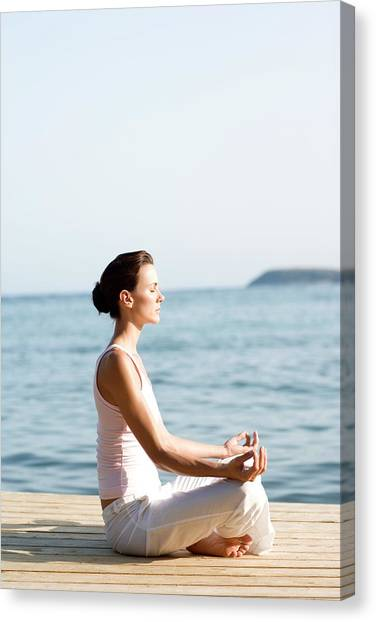 Pontoon Canvas Print - Woman Performing Yoga Exercise by Ian Hooton/science Photo Library