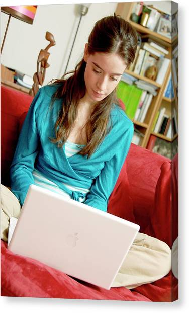 Woman Using A Laptop Computer Canvas Print by Aj Photo/science Photo Library