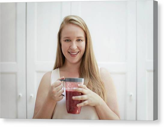 Smoothie Canvas Print - Young Woman Drinking Homemade Smoothie by Science Photo Library
