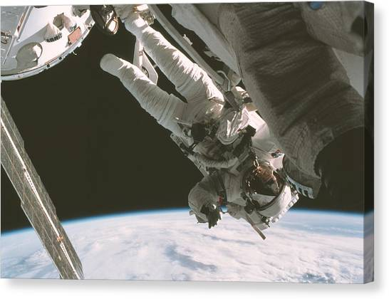 Space Suit Canvas Print - Iss Space Walk by Nasa/science Photo Library