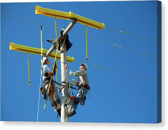 Utility Canvas Print - Repairing Power Lines by Jim West