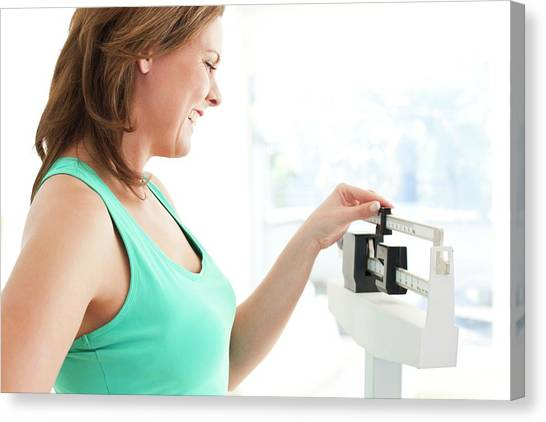 Balance Beam Canvas Print - Woman Weighing Herself by Ian Hooton/science Photo Library