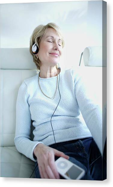Headphones Canvas Print - Woman Listening To Music by Ian Hooton/science Photo Library