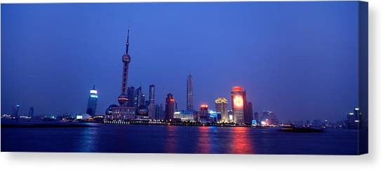 Shanghai Skyline Canvas Print - Buildings At The Waterfront Lit by Panoramic Images