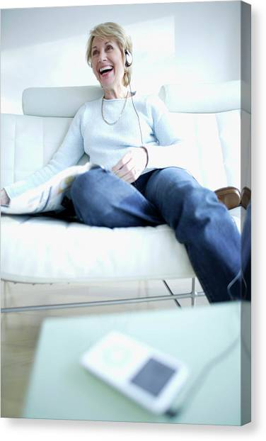Woman Listening To Music Canvas Print by Ian Hooton/science Photo Library