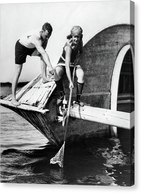 Crabbing Canvas Print - 1920s Man And Woman In Bathing Suits by Vintage Images